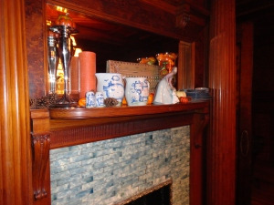 Dining Room mantel with Hadley Pottery plates, bowls, and pitchers