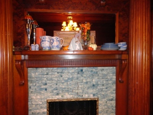 Dining Room mantel featuring Hadley Pottery stoneware pieces